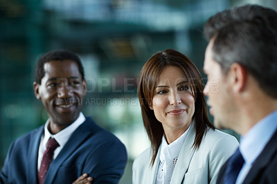 Buy stock photo Shot of businesspeople talking together in the lobby of an office building