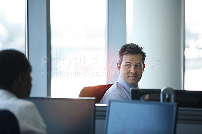 Buy stock photo Shot of two businessmen talking in the office