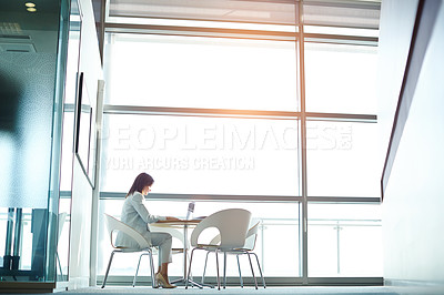 Buy stock photo Shot of a businesswoman working on her laptop in the office