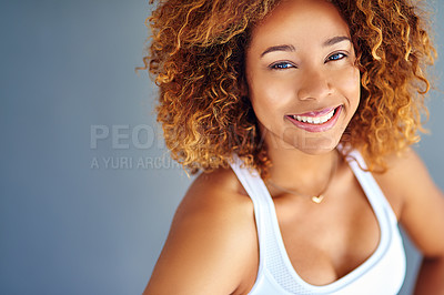 Buy stock photo Cropped shot of a young woman posing against a grey background