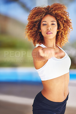 Buy stock photo Portrait of a sporty young woman practising her yoga routine