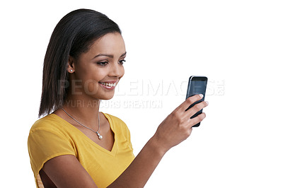 Buy stock photo Studio shot of a young woman taking a picture with a cellphone against a white background