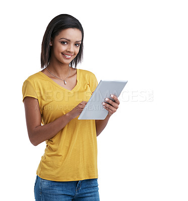 Buy stock photo Studio shot of a young woman using a digital tablet against a white background