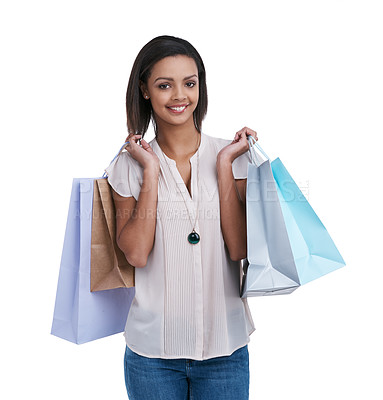Buy stock photo Studio portrait of a young woman carrying shopping bags against a white background