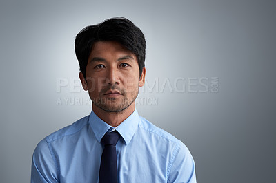 Buy stock photo Studio portrait of a businessman against a gray background