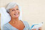 Smiling senior woman reading book