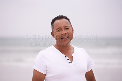 Buy stock photo Cropped shot of a mature man at the beach on a misty morning