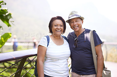 Buy stock photo Cropped portrait of a mature couple hiking in a forest