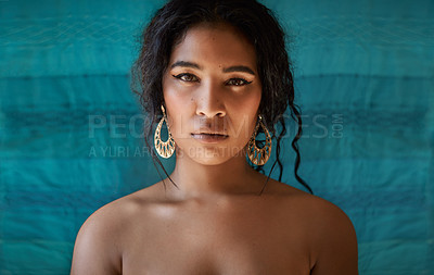Buy stock photo Cropped shot of a beautiful young woman against a blue background