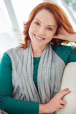 Buy stock photo Cropped portrait of a mature woman relaxing on the sofa at home