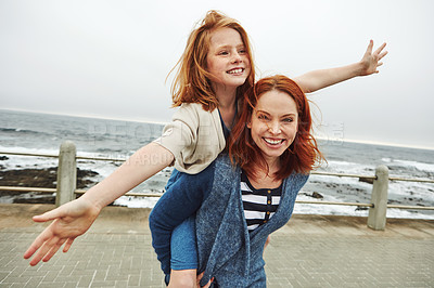 Buy stock photo Shot of a mother giving her daughter a piggyback ride