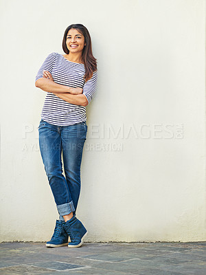 Buy stock photo Portrait of a smiling young woman standing outside