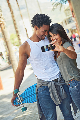Buy stock photo Shot of a young couple taking a selfie together