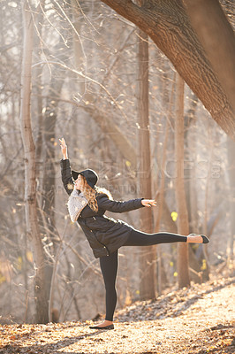 Buy stock photo Shot of a young woman dancing outdoors in winter