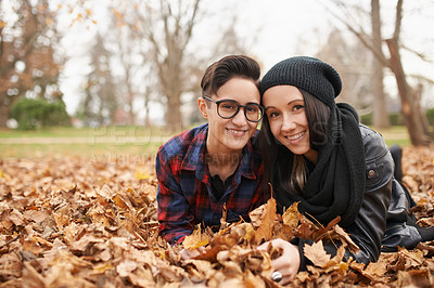 Buy stock photo Portrait of a happy young couple spending an autumn day in the park