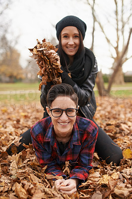 Buy stock photo Portrait of a happy young couple in the park on an autumn day