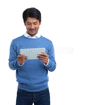 Buy stock photo Studio shot of a businessman using a digital tablet against a white background