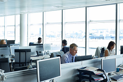 Buy stock photo Shot of businesspeople working at their desks in an office