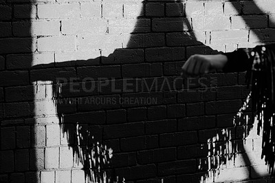 Buy stock photo Shot of a black shot of a woman's reflection against a brick wall