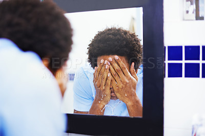 Buy stock photo Shot of a man washing his face at the bathroom sink