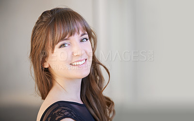 Buy stock photo Shot of a beautiful young woman posing indoors