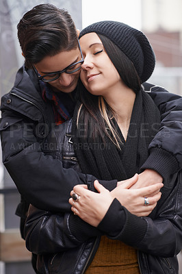 Buy stock photo Shot of an affectionate couple outdoors