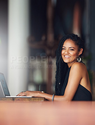Buy stock photo Cropped portrait of an attractive young woman using her laptop in a coffee shop
