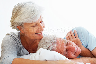 Buy stock photo Closeup of senior couple lying in bed with man sleeping and woman smiling
