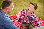 Having a father and son talk in the park