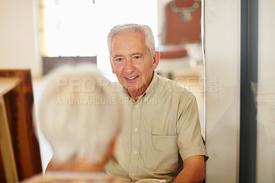 Buy stock photo Shot of a smiling senior couple taking together in a cafe