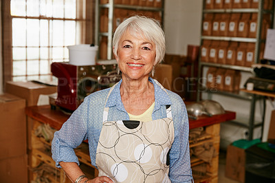 Buy stock photo Cropped portrait of a senior woman standing with her hand on her hip in a roastery
