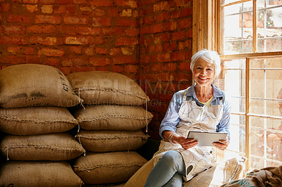 Buy stock photo Cropped portrait of a senior woman using a tablet while working in a roastery