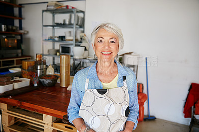 Buy stock photo Shot of a senior woman running a small business