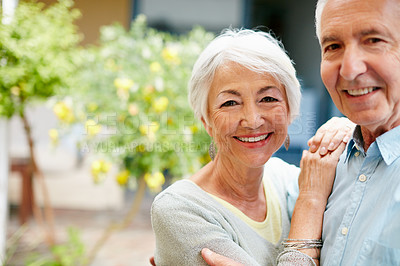 Buy stock photo Portrait of a happy senior couple outdoors