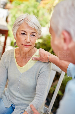Buy stock photo Shot of a caring husband comforting his senior wife
