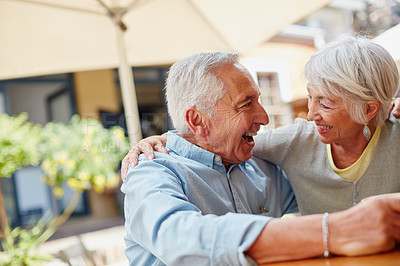 Buy stock photo Shot of a happy senior couple spending time together at a cafe