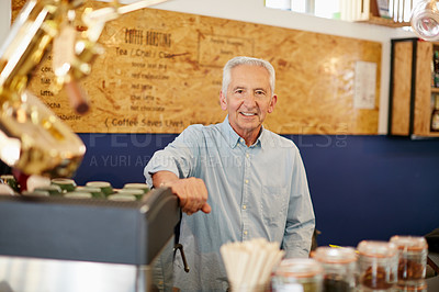 Buy stock photo Shot of a senior man working in a coffee shop