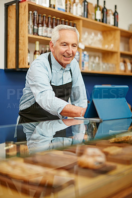 Buy stock photo Shot of a senior man working in a bakery