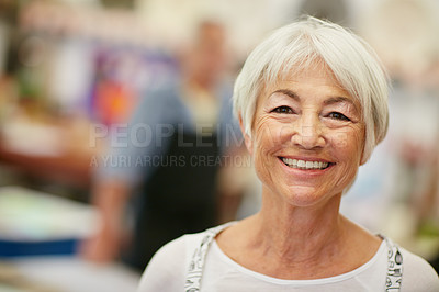 Buy stock photo Shot of a senior woman working in a workshop