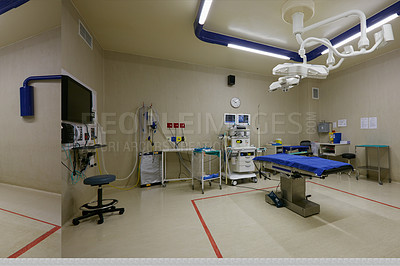 Buy stock photo Shot of monitoring equipment and a bed in an empty hospital ward