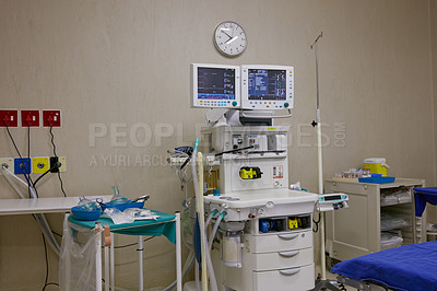 Buy stock photo Shot of monitoring equipment in an empty hospital ward