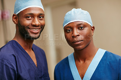 Buy stock photo Cropped portrait of two male nurses standing in a hospital