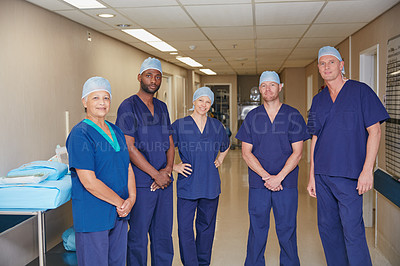 Buy stock photo Cropped portrait of a medical team standing in a hospital