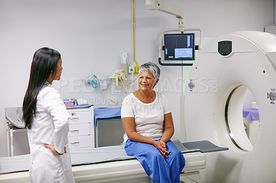 Buy stock photo Shot of a senior woman talking with a doctor before and MRI scan