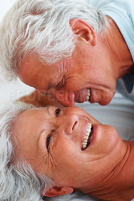 Buy stock photo Closeup of romantic senior couple relaxing in bed