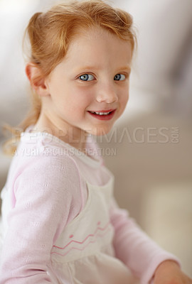 Buy stock photo Closeup portrait of an adorable little girl giving you a cute smile