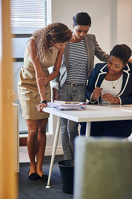 Buy stock photo Shot of a group of female colleagues talking together in an office