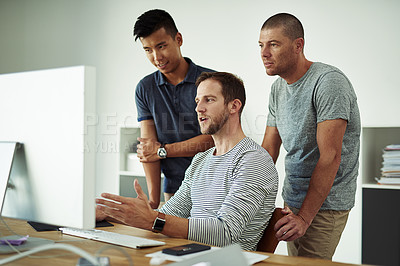 Buy stock photo Cropped shot of three designers working together on a project in an office