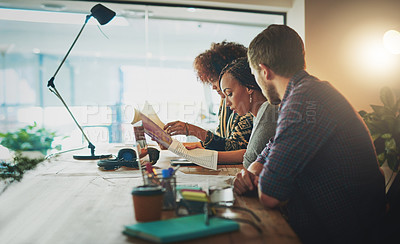 Buy stock photo Shot of a group of colleagues working on a project together in a modern office