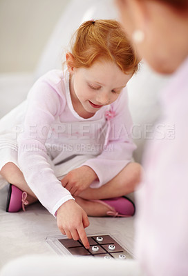 Buy stock photo Portrait of a granddaughter playing tic tac toe game with her grandmother